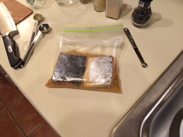 I'm making half the recipe, so half the marinade and half the salmon. Place fish skin-side up in marinade.